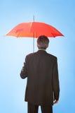 Senior businessmen holding a umbrella. Portrait of senior businessmen holding a umbrella. Insurance concept Stock Photo
