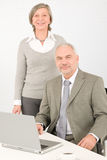 Senior businesspeople behind office table computer Royalty Free Stock Photos