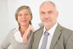 Senior businesspeople leaning over shoulder Stock Photography