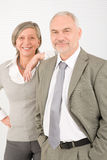 Senior businesspeople leaning over shoulder Stock Images