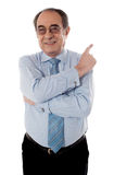 Senior businessperson pointing away Royalty Free Stock Photo