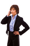 Senior businesswoman calling on phone Stock Image
