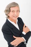 Senior businesswoman crossed arms portrait smart Royalty Free Stock Photo
