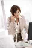 Senior businesswoman at desk Stock Photos