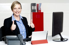 Senior businesswoman gesturing thumbs up Royalty Free Stock Images