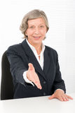 Senior businesswoman handshake close deal smiling Stock Photo