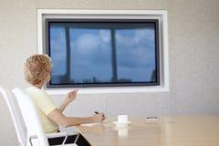 Senior Businesswoman Having Video Conference In Boardroom Stock Photos