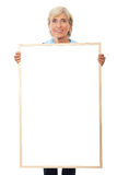 Senior businesswoman holding placard Stock Images
