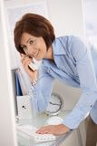Senior businesswoman on landline phone call Royalty Free Stock Photos