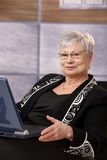 Senior businesswoman with laptop Stock Photo