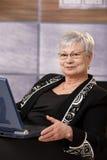 Senior businesswoman with laptop Stock Photo