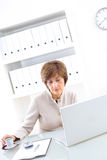 Senior Businesswoman with laptop Royalty Free Stock Images