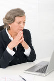 Senior businesswoman look seriously at computer Stock Images