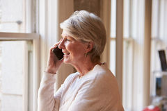 Senior Businesswoman On Mobile Phone In Office Royalty Free Stock Photo