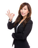 Senior businesswoman with ok sign Royalty Free Stock Image