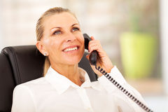 Senior businesswoman phone Stock Photography