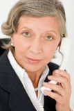 Senior businesswoman on phone close-up portrait Stock Photography