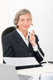 Senior businesswoman on phone hold empty sheet Stock Images