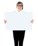 Senior businesswoman posing with blank placard Stock Image
