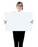 Senior businesswoman posing with blank placard stock image