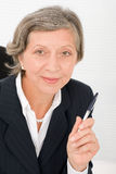 Senior businesswoman professional hold pen Stock Image