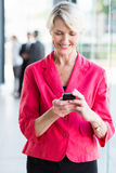 Senior businesswoman smart phone Royalty Free Stock Image