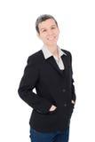 Senior businesswoman smiles over white Stock Photography