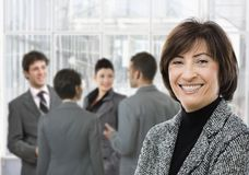 Senior businesswoman smiling Stock Photo