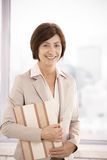 Senior businesswoman smiling in office Stock Images