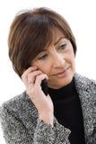 Senior businesswoman talking on mobile Stock Images