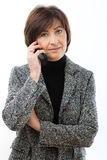 Senior businesswoman talking on mobile Stock Images
