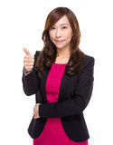 Senior businesswoman thumb up Stock Images