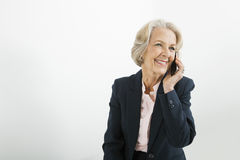Senior businesswoman using cell phone in office Stock Photos