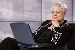 Senior businesswoman using computer Royalty Free Stock Images