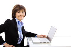 Senior businesswoman using laptop computer Stock Photos