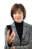 Senior businesswoman using mobile Stock Photography