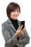 Senior businesswoman using mobile phone Royalty Free Stock Image