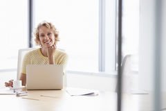 Senior Businesswoman Working On Laptop At Boardroom Table Royalty Free Stock Image