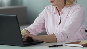 Senior businesswoman working on laptop computer at home, modern technologies. Stock footage stock video footage