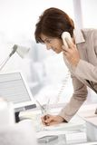 Senior businesswoman working in office Stock Photography
