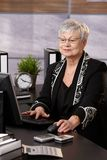 Senior businesswoman working in office Royalty Free Stock Images