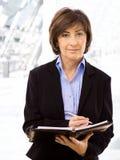 Senior businesswoman writing Royalty Free Stock Images