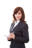 Senior businesswoman writing notes, smiling and stock images