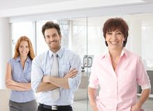 Senior businesswoman and young colleagues Stock Images