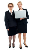 Senior businesswomen posing with laptop Stock Photography