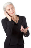 Senior businesswomen uses cell phone Stock Images