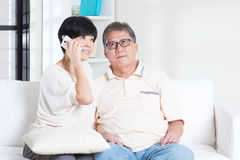 Senior calling on smart phone Stock Photo