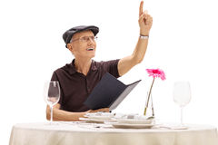 Senior calling a waiter in a restaurant Royalty Free Stock Photography