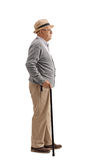 Senior with a cane waiting in line. Full length profile shot of a senior with a cane waiting in line isolated on white background Stock Image