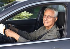 Senior car driver. Old man car driver in vehicle. Transportation insurance concept Royalty Free Stock Photos